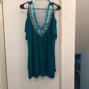 Teal sequin neck line shirt from DEB.